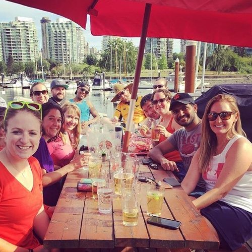 Jokers enjoying drinks on the best deck in Vancouver